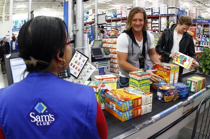 Florida Georgia Line's Tyler Hubbard, center, and Brian Kelley check out at Sam's Club in support of Outnumber Hunger, in Nashville, Tenn