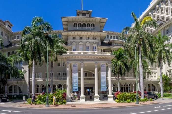 HONOLULU, HI - AUG 3: Front exterior panorama of the Moana Surfrider on August 3, 2016 in Honolulu. Known as the First Lady of Waikiki, is a famous historic hotel on the island of Oahu built in 1901.