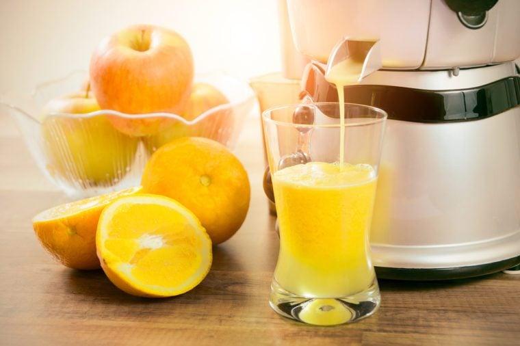 Juicer prepares fresh and healthy juice. juicer juice extractor fresh blender machine concept