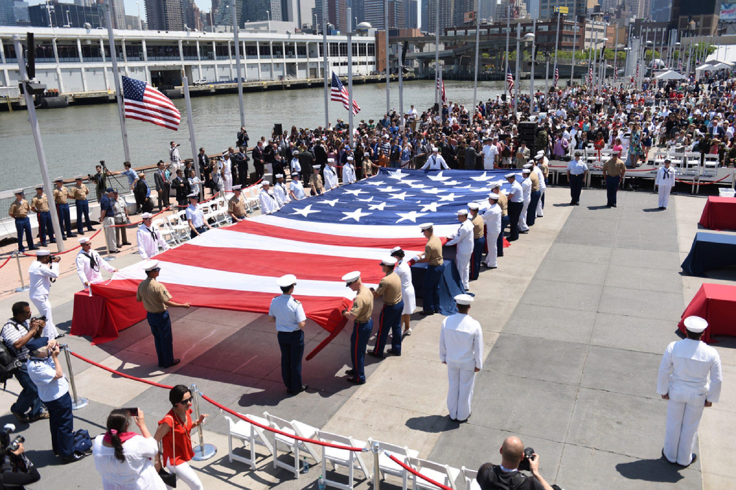 NEW YORK CITY - 25 MAY 2015: Mayor Bill de Blasio & Gen John Kelly presided over Memorial Day observances on Pier 86 by the USS Intrepid. Unfurling enormous US flag