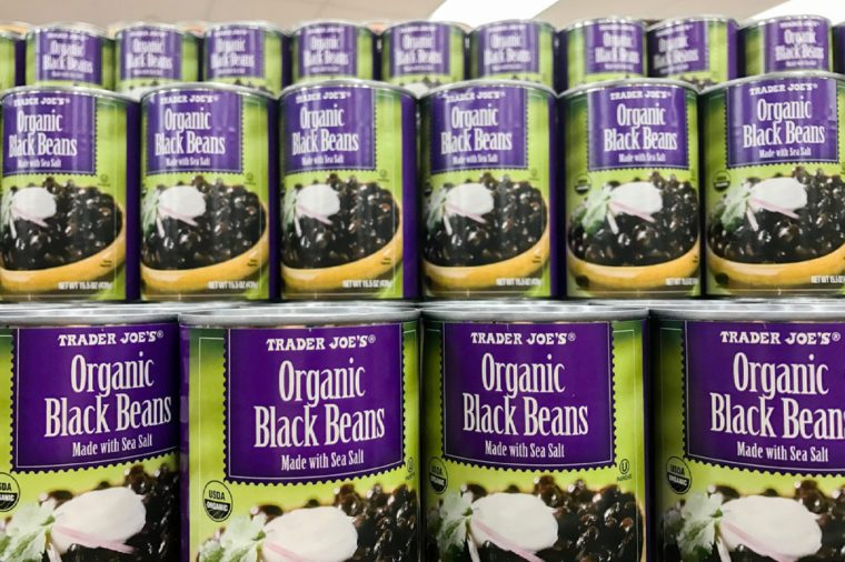 New York, February 14, 2017: Cans of Organic Black Beans are stacked on a shelf in a Trader Joe's store.