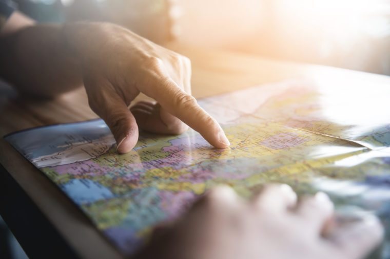 Tourist planning on vacation. Close up people hands on the map.