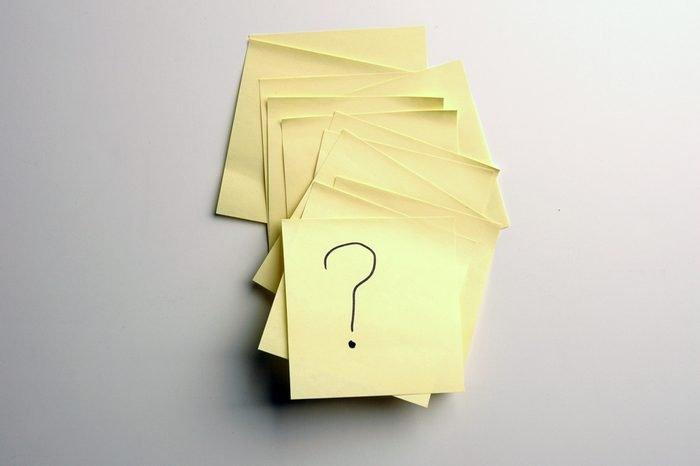 post it note on a white board with a question mark symbol
