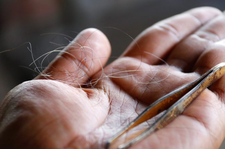 Gray hair : The gray hair was pulled together on the palm : Close up of white hair and iron clamp hair on the palms of men.