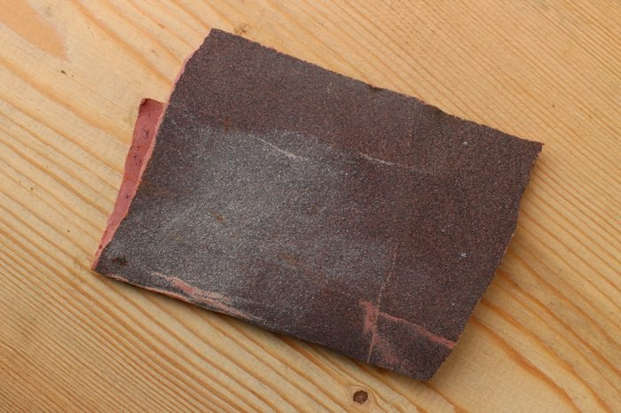 Sandpaper on a wooden background closeup