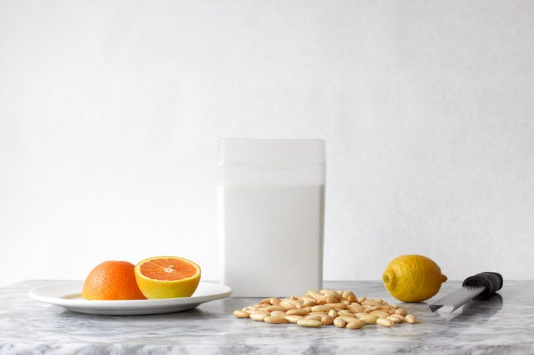 Minimal Still Life with Orange, Lemon, Almonds and Sugar