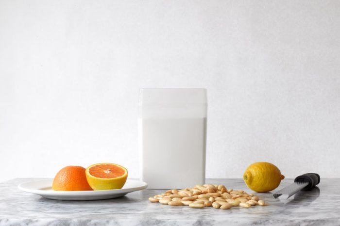 Minimal Still Life with Orange, Lemon, Almonds and Sugar