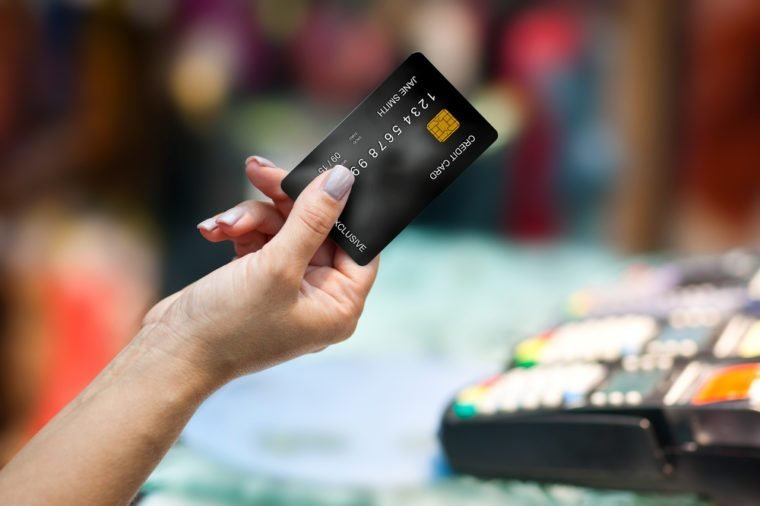 close up of woman hand holding credit card