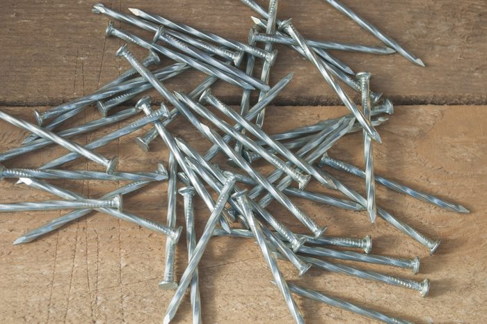 Steel nails on a wood background