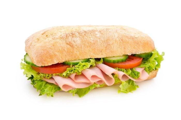 Chicken breast sandwich isolated on white