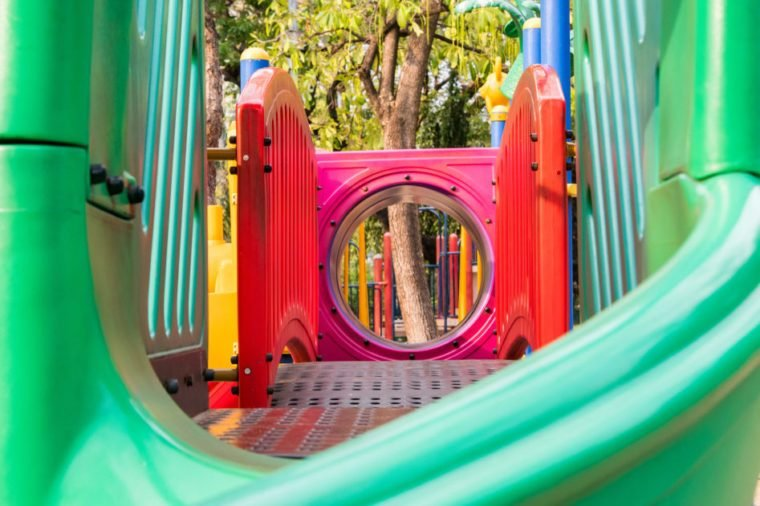 inside colourful outdoor playground equipment in park.