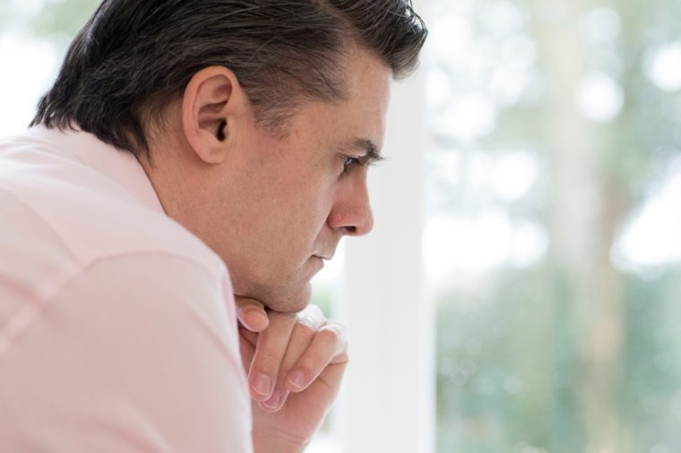 Profile View Of Worried Mature Man At Home
