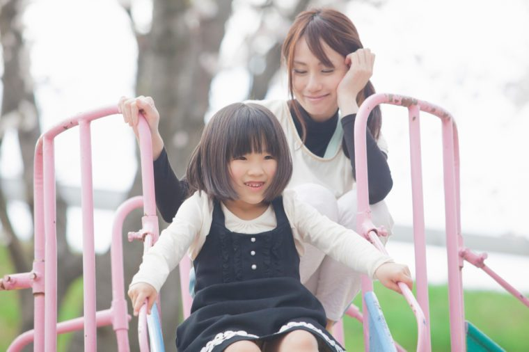 Japanese parents and children playing in the park