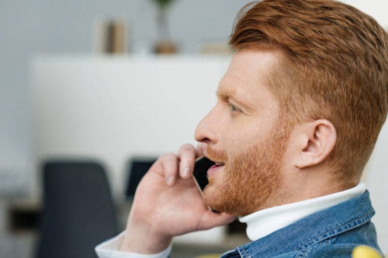 Handsome bearded man talking on phone