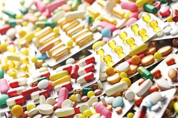 Pills close up and colorful blister packs