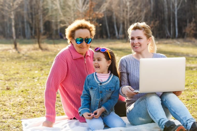 A small girl with mother and grandmother in the park