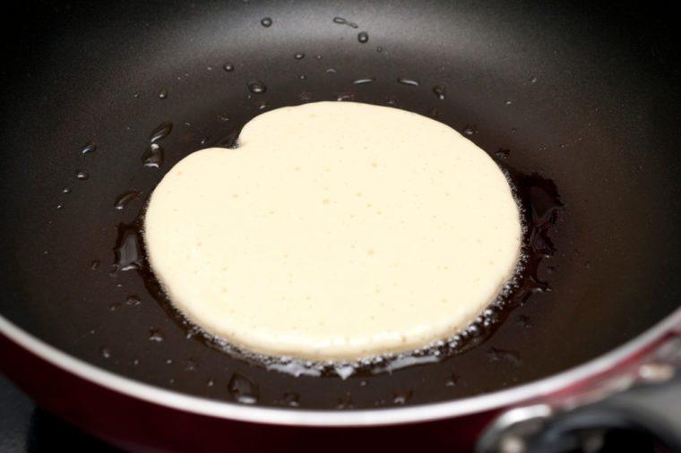 Making pancakes on frying pan
