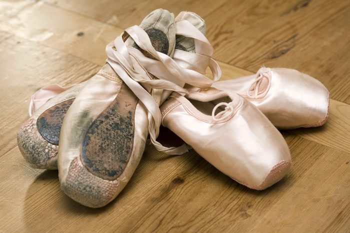 Pairs of old and new ballet shoes