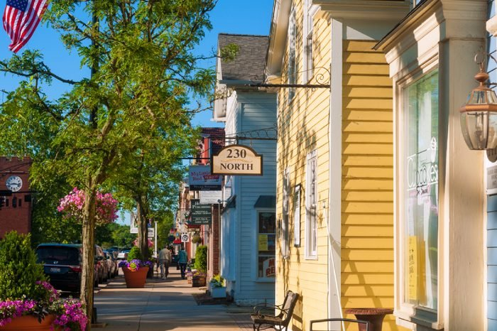 HUDSON, OH - JUNE 14, 2014: Quaint shops and businesses on Hudson's Main Street maintain a charming and inviting appearance that makes it a pedestrian shopper's mecca.