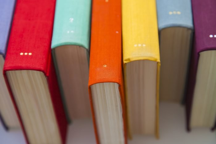 Stack of vintage books in multicolored covers