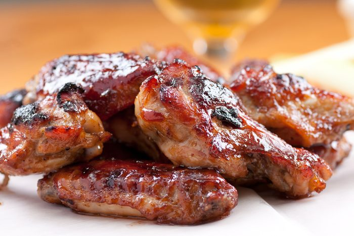 spicy asian style chicken wings with sauce and beer