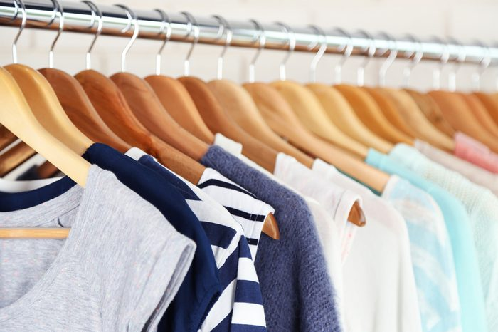 Different clothes on hangers close up