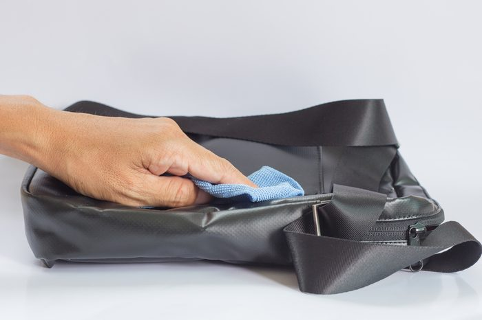 Black Leather Bag cleaning with a Microfiber Cloth