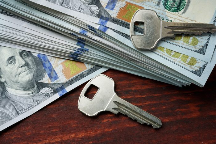 Keys and money on a table. Mortgage loan concept.