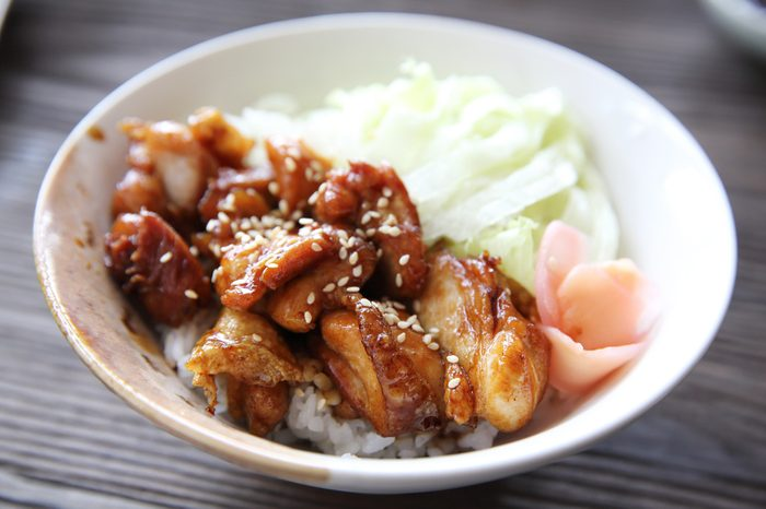 Grilled Chicken teriyaki rice on wood background , japanese food