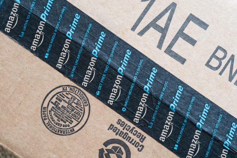 HOUSTON, US-AUG 23, 2016:Amazon Prime logotype printed on cardboard box security scotch tape. It is a membership program offerfree shipping, access to streaming video, music, e-book for $99 per year