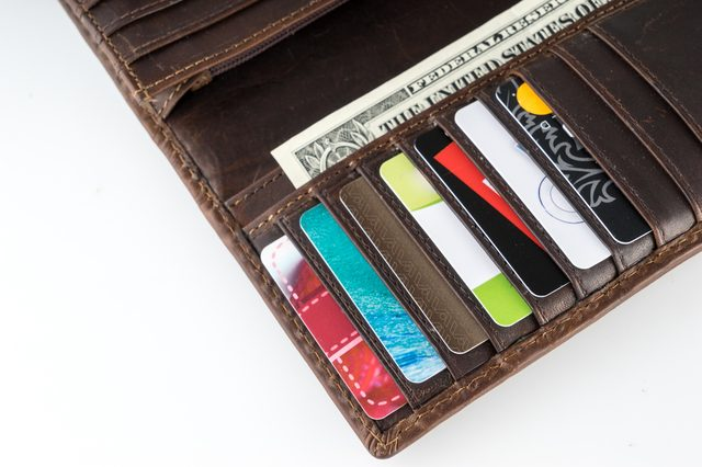 Brown leather wallet with money, credit and discount cards