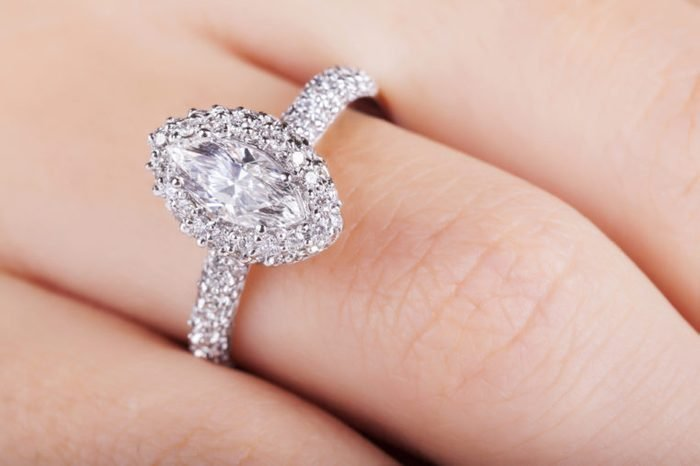 Close up of elegant diamond ring. Close up of elegant diamond ring on the finger. Diamond ring.