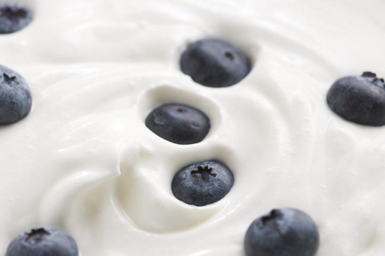 Blueberries in organic yogurt, 4k close up photo