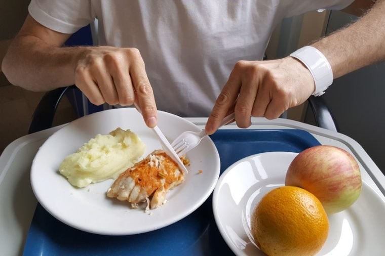 Man eating hospital food