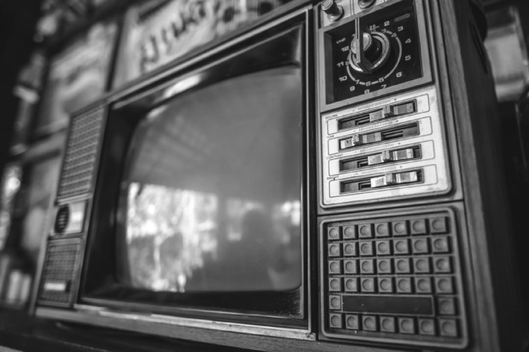Antique grunge portable black and white television screen in vintage style.