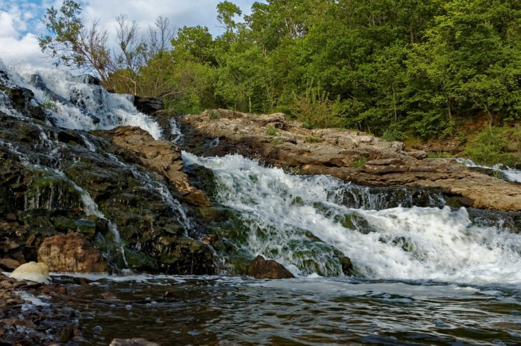Water rushes over the Lake MacBride Waterfall