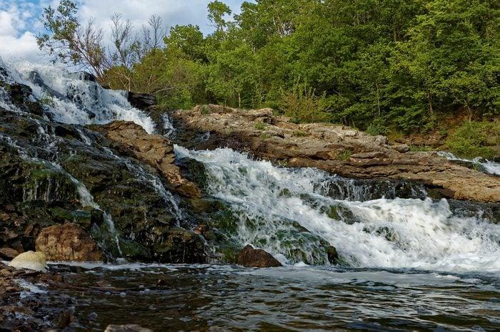 Water rushes over the Lake MacBride Waterfall