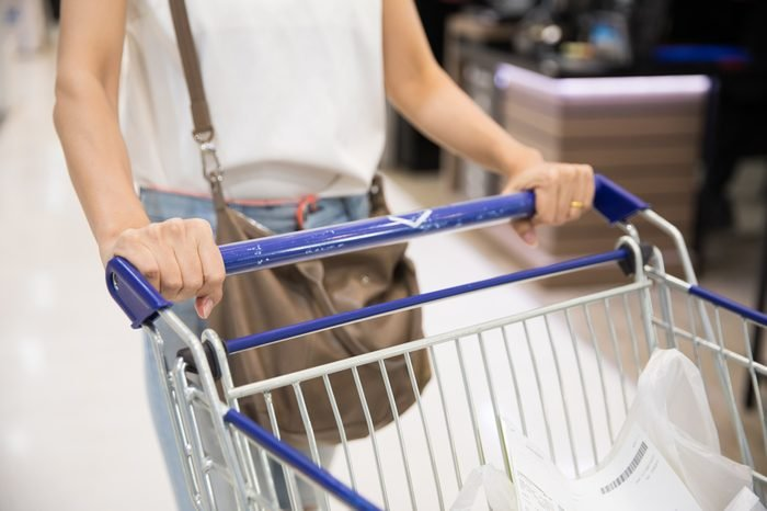 Woman grocery shopping in a supermarket