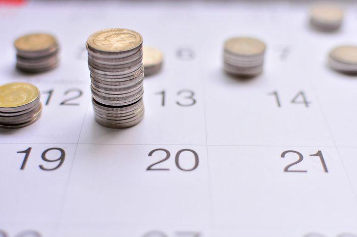 coins saving growth up on calendar concept saving business and finance