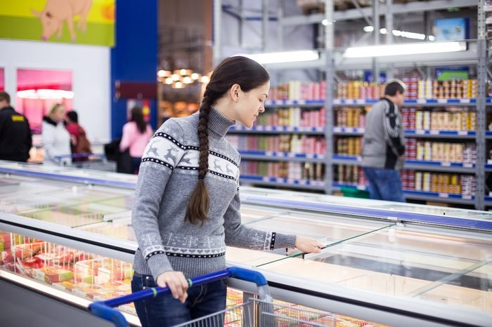 girl makes a purchase at the grocery hypermarket