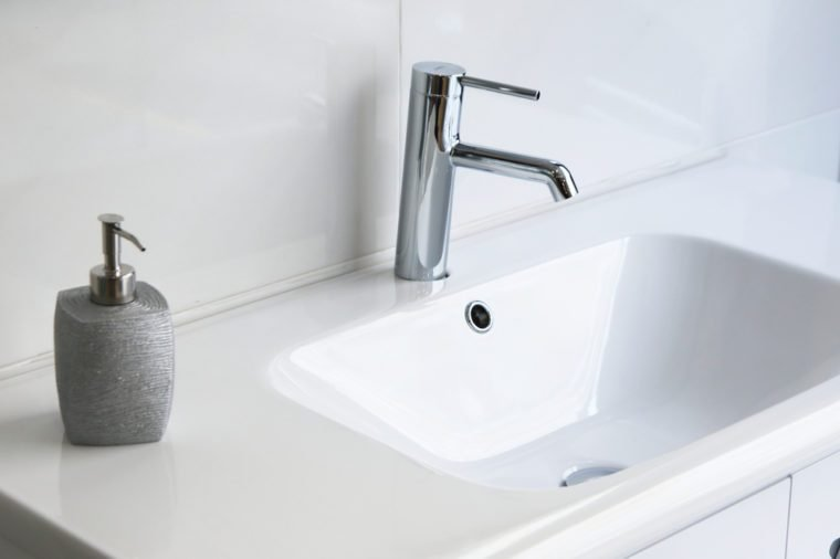 modern and clean bathroom sink and soap dispenser