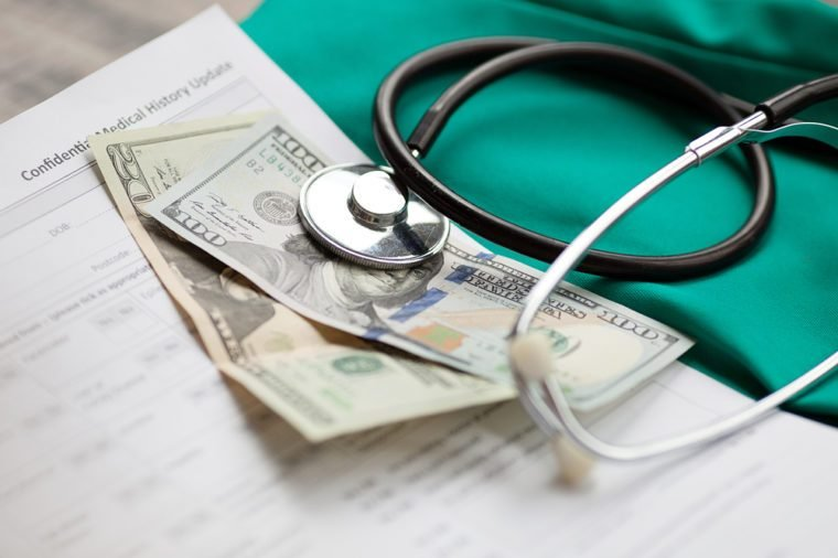 Dollars with stethoscope on them. Costs for the medical insurance.