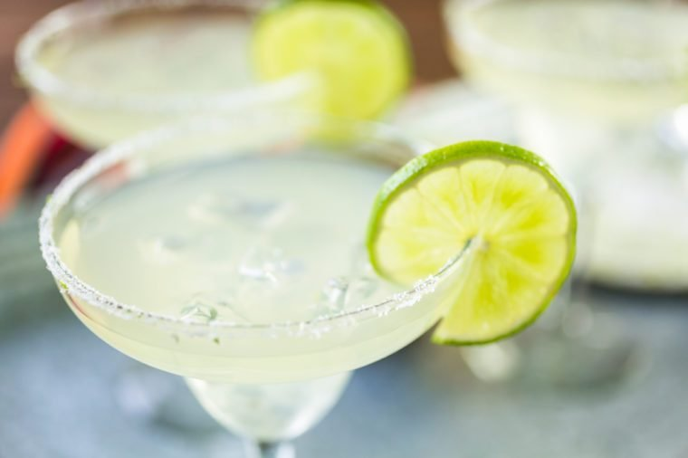 Key lime margarita garnished with fresh lime in margarita glass.