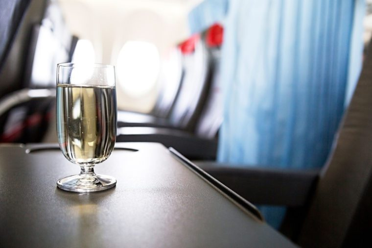 photo of glass of wine in the plane