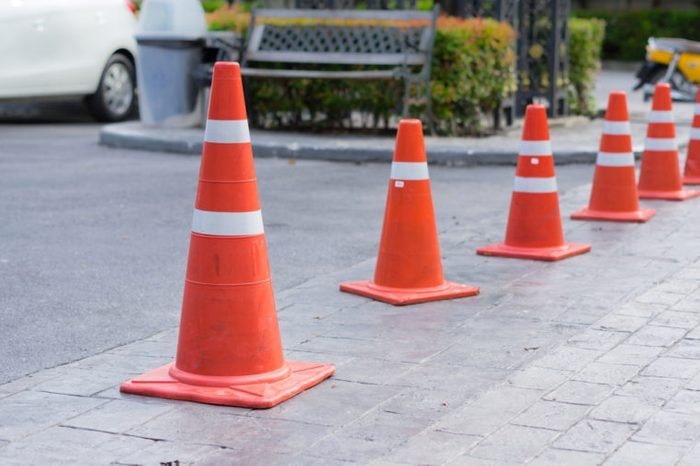 Traffic Cones or witches hat at parking area.