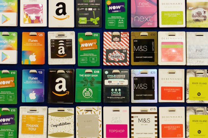 BATHGATE, SCOTLAND, UK - OCTOBER 11, 2017. A display rack of gift cards for different retailers.