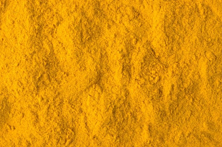 texture of turmeric powder close-up, spice or seasoning as background