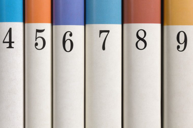 Six colored numbered books in a row