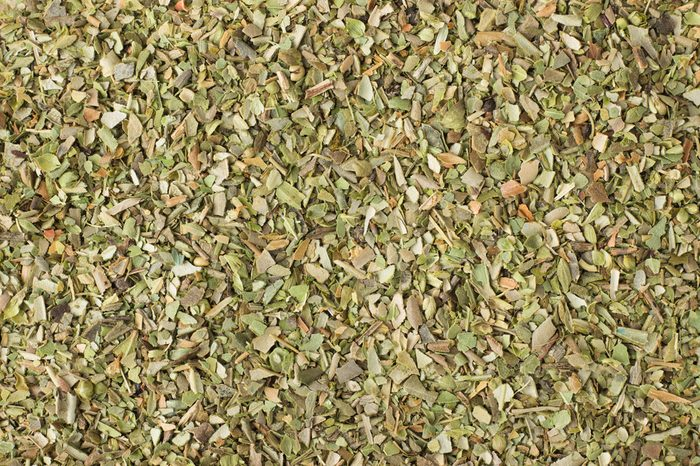 texture of dried oregano close-up, spice or seasoning as background