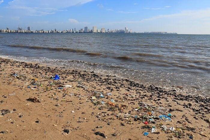 MUMBAI INDIA - NOVEMBER 12, 2017: Rubbish scattered in Chowpatty beach Mumbai.